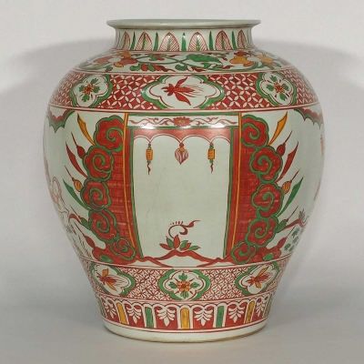 Jar with Figures Design