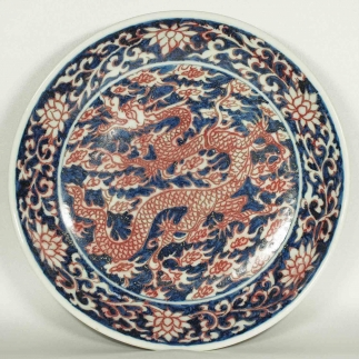 Plate with Dragon on Blue Background Design